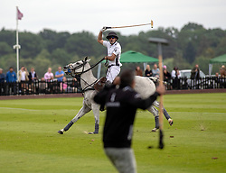 La Indiana's Facundo Pieres celebrates scoring the winning goal the Cartier Queen's Cup final at Guards Polo Club, Windsor Great Park, Surrey.