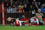 Tommy Bowe of the British&Irish Lions scores in the corner with Jannie Boshoff to late to stop him. Photographer Stu in the background.<br /> Rugby - 090602 - British&Irish Lions v Xerox Lions - Coca-Cola Park - Johannesburg - South Africa.<br /> Photographer : Anton de Villiers / SASPA
