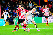 Exeter City's Jordan Moore-Taylor and Port Vale's AJ Leitch-Smith battle for the ball during the The FA Cup match between Exeter City and Port Vale at St James' Park, Exeter, England on 6 December 2015. Photo by Graham Hunt.