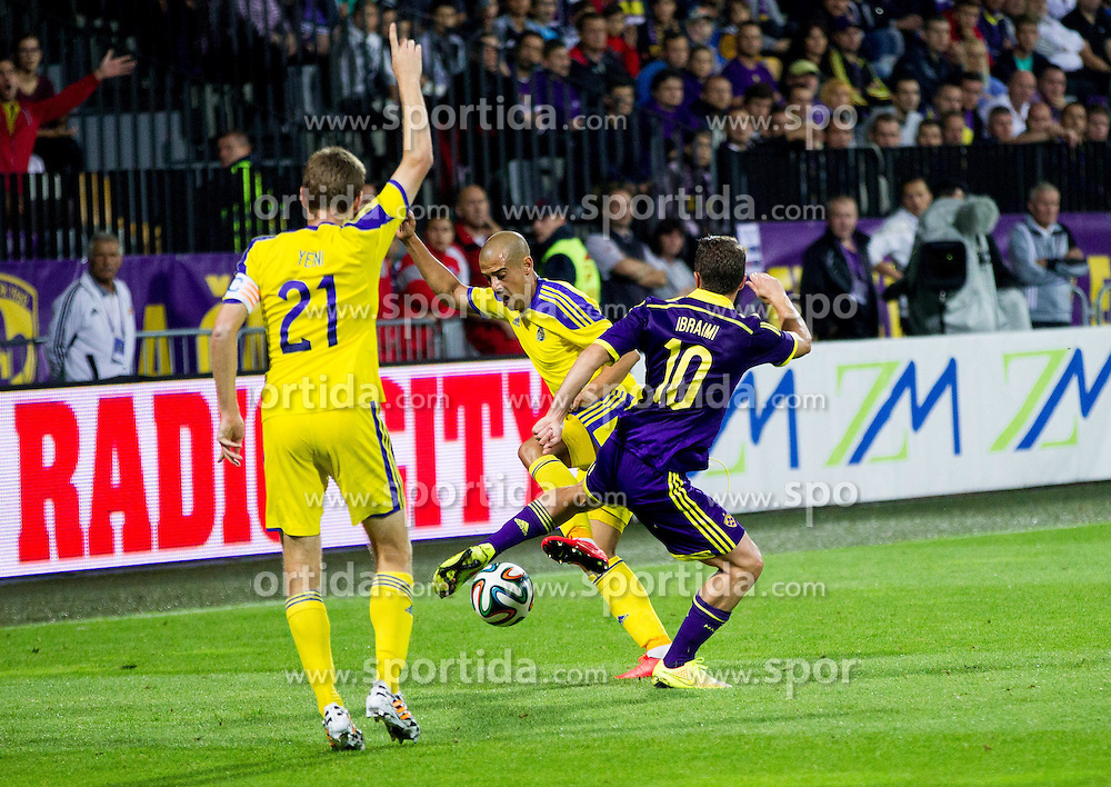 Tal Ben Haim of Maccabi vs Agim Ibraimi #10 of Maribor during football match between NK Maribor and Maccabi Tel Aviv FC (ISR) in Third qualifying round of UEFA Champions League on July 30, 2014 in Stadium Ljudski vrt, Maribor, Slovenia. Photo by Vid Ponikvar / Sportida.com