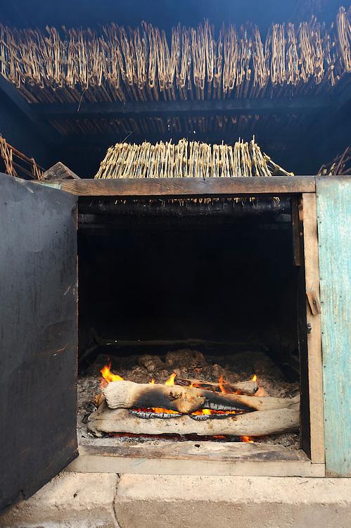 Roa fish being smoked, Bangga, Gorontalo, Sulawesi, Indonesia.