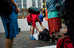 © Licensed to London News Pictures. 23/06/2017. London, UK. A boy packs his bags in the street as residents are evacuated from the Taplow block of the Chalcots Estate in Camden after it failed a fire inspection because of combustable cladding. Prime Minister Theresa May has told Parliament that up to 600 high rise tower blocks may have similar cladding to that found in Grenfell Tower, which went on fire last week, in which as many as 79 residents are thought to have perished Photo credit: Ben Cawthra/LNP