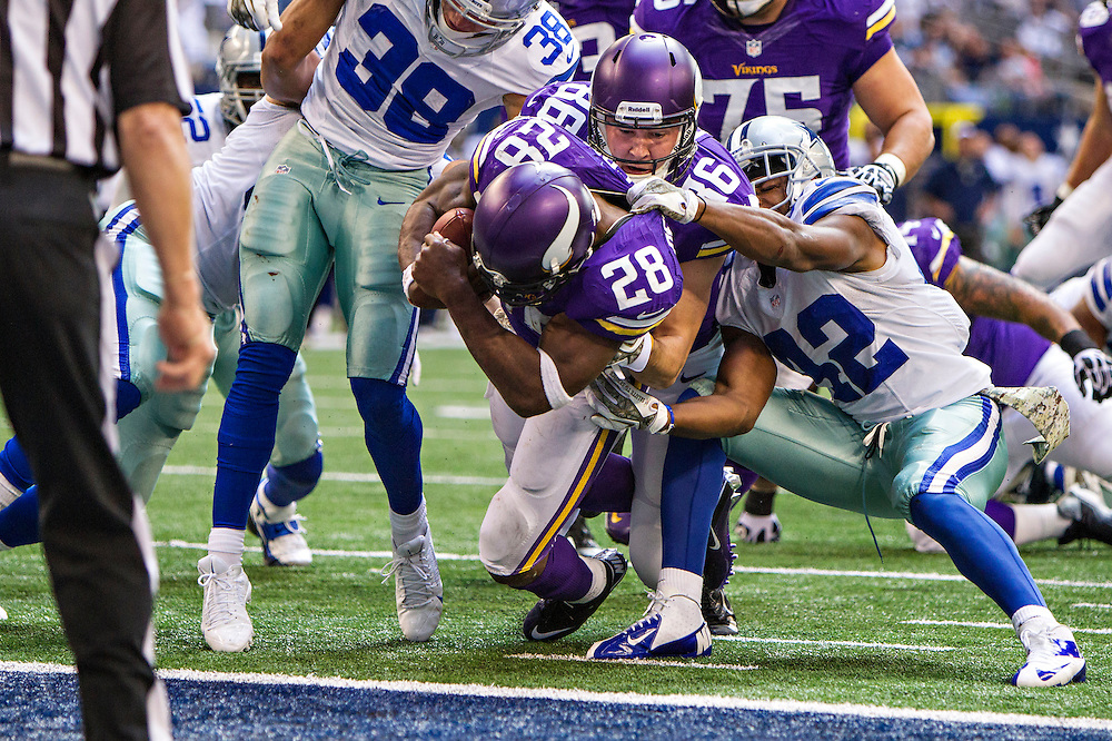 ARLINGTON, TX - NOVEMBER 3:  Adrian Peterson #28 is helped into the end zone by Chase Ford #86 of the Minnesota Vikings for a touchdown against the Dallas Cowboys at AT&T Stadium on November 3, 2013 in Arlington, Texas.  The Cowboys defeated the Vikings 27-23.  (Photo by Wesley Hitt/Getty Images) *** Local Caption *** Adrian Peterson; Chase Ford