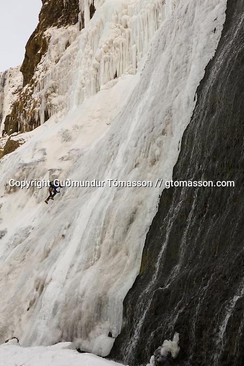 "Róbert Halldórsson at the base of the ice climb  ""Bjarta hlíðin"" WI6, Eyjafjöll."
