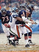Chicago Bears quarterback Jay Cutler (6) gets hit from behind and stripped of the ball by Seattle Seahawks defensive end Raheem Brock (98) during the NFL 2011 NFC Divisional playoff football game against the Seattle Seahawks on Sunday, January 16, 2011 in Chicago, Illinois. The Bears won the game 35-24. ©Paul Anthony Spinelli