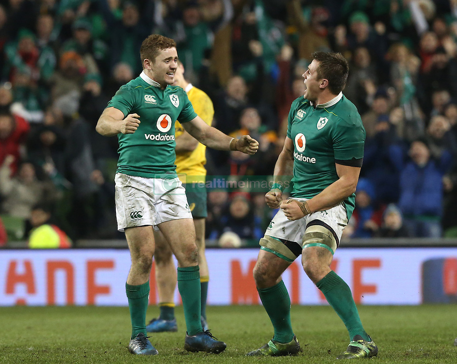 Ireland's Paddy Jackson and CJ Stander (right) celebrate victory after the Autumn International match at the Aviva Stadium, Dublin.