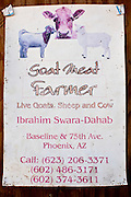 30 OCTOBER 2010 - PHOENIX, AZ: The sign at the Goat Meat Store, owned by Ibrahim Swara-Dahab, in Phoenix, AZ. Swara-Dahab came to the United States from Somalia in 1998. He has built a thriving business as a Halal butcher and provides freshly butchered goats and sheep killed following the precepts of Muslim tradition. His business not only caters to Muslims in the Phoenix area but also to refugees and immigrants from Africa and Asia.  His small butcher shop is on the Gila River Indian Reservation, about 100 yards from the Phoenix city limits and doesn't have either running water or electricity.   Photo by Jack Kurtz