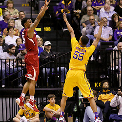 Jan 16, 2016; Baton Rouge, LA, USA; Arkansas Razorbacks guard Anthlon Bell (5) shoots over LSU Tigers guard Tim Quarterman (55) during the first half of a game at the Pete Maravich Assembly Center. Mandatory Credit: Derick E. Hingle-USA TODAY Sports