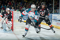 KELOWNA, CANADA - FEBRUARY 28: Chance Braid #22 of Kelowna Rockets skates in front of Adam Tambellini #19 of Calgary Hitmen during first period on February 28, 2015 at Prospera Place in Kelowna, British Columbia, Canada.  (Photo by Marissa Baecker/Shoot the Breeze)  *** Local Caption *** Chance Braid; Adam Tambellini;