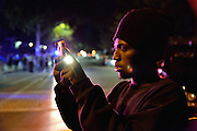 A young man films the police and crime scene.<br /> <br /> At a vigil to commemorate the death of 18 year old VonDerrit Myers Jr. at the hands of an armed security guard, an dispute breaks out between two groups at the street intersection.<br /> At least four shooters are involved in a violent 2 minute shoot out which saw at least 58 bullets fired. Participants dive for cover and flee.<br /> Once it is over, one man lies injured, others are sped away in vehicles or run off. Blood and shell casings litter the street, and as the police secure the crime scene, the pastor calls the people to gather around and continue the vigil to honor the dead teenager. Another day of urban violence in the USA.
