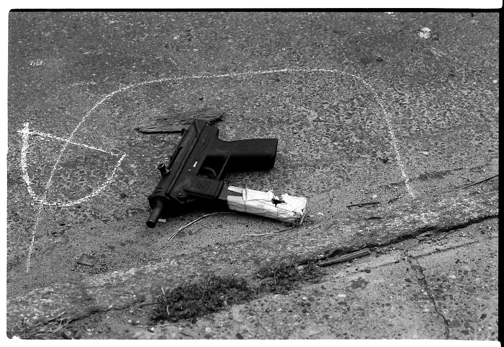 Crime Scene- An Uzi is circled in chalk after a drug territory shootout left both men dead