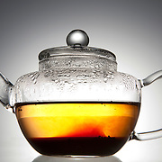 Pu erh brewing in a glass tea pot.