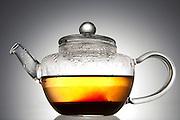 Pu erh brewing in a glass tea pot.