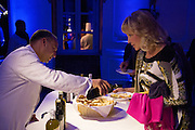 A waiter serves a guest at the 10th birthday party of the Swiss Teoxane cosmetics group.<br /> Rome, Italy<br /> Client: Withup