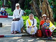 27 NOVEMBER 2017 - YANGON, MYANMAR: Catholic nuns and lay people wait to see Pope Francis on the Pontiff's motorcade route into Yangon. Pope Francis arrived in Yangon Monday for a four day / three night visit. Tuesday he is going to the capitol, Naypyidaw (Nay Pyi Taw) to meet with Aung San Suu Kyi and other Myanmar leaders. Wednesday and Thursday he is saying mass in Yangon and on Thursday afternoon he is going to neighboring Bangladesh. There are around 450,000 Catholics in Burma, about 1% of the total population.   PHOTO BY JACK KURTZ