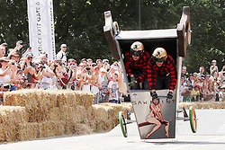 © Licensed to London News Pictures . 14/07/2013 . London, UK . A competitor crashes in the final stage of the Red Bull Soapbox Race 2013 at Alexandra Park, London. Photo credit : Isabel Infantes /LNP