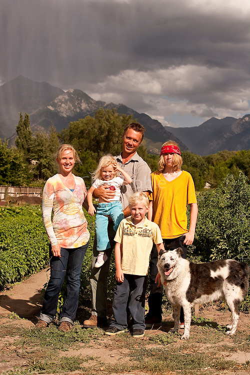 "Jill and Dave Bell, owners of Bell Organic Gardens, with their children Anna, Reid, Max, and dog ""Boo"" at their farming operation in Sandy Utah."