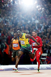 Olympics - London 2012 Olympic Games - 5/8/12.Athletics - Men's 100m Final - Jamaica's Usain Bolt  after winning the race to get gold.© pixathlon