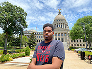 "Today at the Mississippi State Capitol 29 yr old history teacher from Cardozo Middle School ,Dhahran Hall, spoke truth to power and lead  demonstrators in support of Black Lives Matter and against the brutal  murder of George Floyd and police brutality and systematic racism. Protestors gathered at the State Capitol and marched around downtown Jackson returning to the Capitol they chanted "" Say There Names"", "" I can't Breathe"", "" No Justice No Peace"" "" Justice for George Floyd"" it was a very peaceful protest and march.  In the past 6 days protests and riots have broken out across America in response to the brutal killing of an unarmed African American man by the knee and hands of Minnesota Police<br />