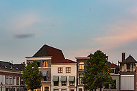 Homes along the canal in Gorichem, Netherlands are attached to each other, rise up to three stories and made of brick.