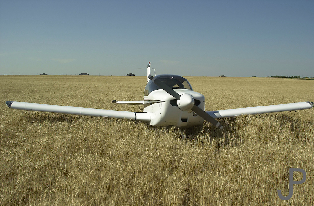Grumman Tiger N9445L after Lewis ran short of fuel and landed in field.  I had just sold the airplane to him and told him to be careful about the fuel.