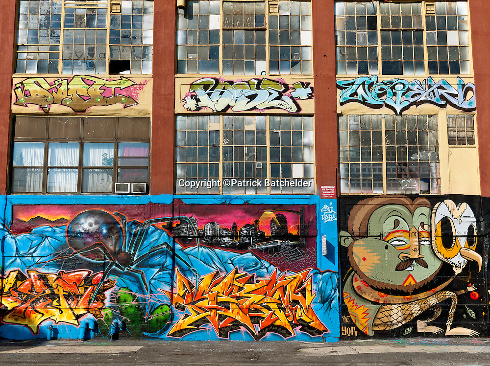 "Graffiti murals adorn the walls of 5 Pointz, the ""Graffiti Museum"" once located in Quenns, New York,"