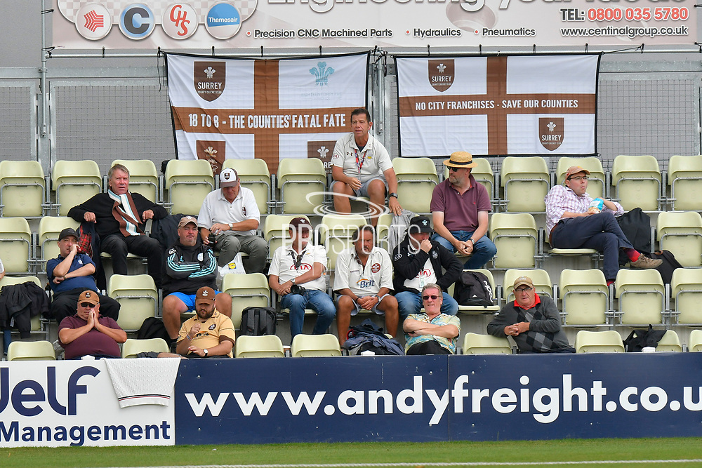 A small group of Surrey Supporters in the stands with their flags hanging behind them during the final day of the Specsavers County Champ Div 1 match between Worcestershire County Cricket Club and Surrey County Cricket Club at New Road, Worcester, United Kingdom on 13 September 2018.