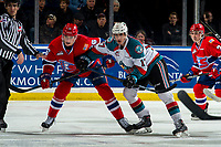 KELOWNA, CANADA - MARCH 13: Jack Finley #26 of the Spokane Chiefs is checked by Alex Swetlikoff #17 of the Kelowna Rockets after the face off in third period on March 13, 2019 at Prospera Place in Kelowna, British Columbia, Canada.  (Photo by Marissa Baecker/Shoot the Breeze)