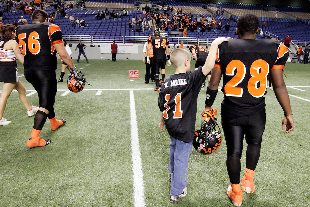 Michael Zamora/Caller-Times.Refugio water boy Michael Moore offers a consoling pat on the shoulder to Marquise Brown as the Bobcats come off the field Saturday, Dec. 6, 2008 following their playoff loss at the Alamodome in San Antonio. .