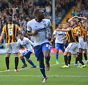 Nathan Cameron peels away to celebrate his goal during the Sky Bet League 1 match between Bury and Port Vale at Gigg Lane, Bury, England on 19 September 2015. Photo by Mark Pollitt.