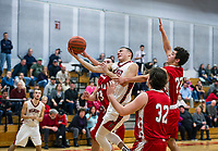 Belmont's Matt Pluskis charges through Laconia's defense for a shot to the basket during NHIAA Division III Basketball Tuesday evening.  (Karen Bobotas/for the Laconia Daily Sun)