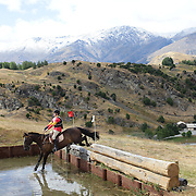 Lee Warren riding Zedd in action at the water jump during the Cross Country event at the Wakatipu One Day Horse Trials at the Pony Club grounds,  Queenstown, Otago, New Zealand. 15th January 2012. Photo Tim Clayton