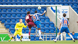 COLCHESTER, ENGLAND - Saturday, September 25, 2010: Things get worse for Tranmere Rovers as Colchester United's Magnus Okuonghae (C) scores with his head to give his team a 3-0 lead during the League One match at the Colchester Community Stadium. (Photo by Gareth Davies/Propaganda)