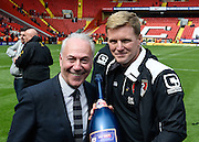 Bournemouth chairman Jeff Mostyn and Bournemouth manager Eddie Howe pose with the Sky Bet Championship trophy after the Sky Bet Championship match between Charlton Athletic and Bournemouth at The Valley, London, England on 2 May 2015. Photo by David Charbit.