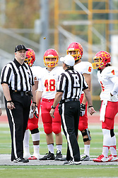 19 September 2015:   Coin toss with referee Dave Wallace, Umpire Jeff Conrad, Michael Conner (48), Nate Connealy (4) and Sammy Sasso (6) during an NCAA division 3 football game between the Simpson College Storm and the Illinois Wesleyan Titans in Tucci Stadium on Wilder Field, Bloomington IL