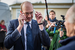 © Licensed to London News Pictures . 19/11/2014 . Kent , UK . UKIP candidate MARK RECKLESS (centre) at Hoo Marina Park in Rochester , surrounded by media , to canvas votes . The Rochester and Strood by-election campaign following the defection of sitting MP Mark Reckless from Conservative to UKIP . Photo credit : Joel Goodman/LNP