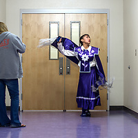 Sarah Ann Gilmore practices the motions for the shawl dance with help from her aunt, Amber Dennison, in a hallway behind the gym at Miyamura High School, Tuesday. Gilmore participated in the ninth annual GMCS Navajo Language and Culture Festival, a week long event hosted at district schools to showcase traditional native songs and dances.