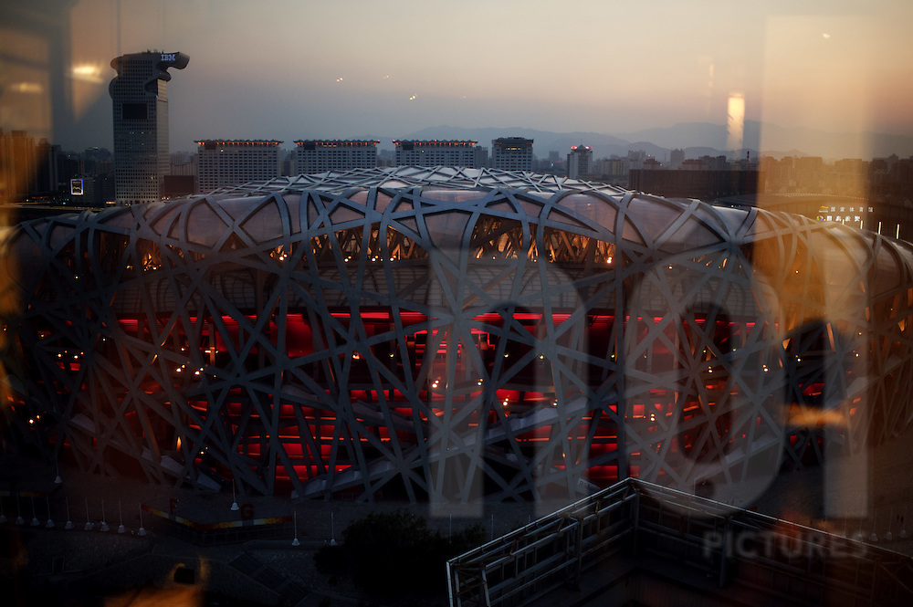 View of the Bird Nest olympic stadium through a window at sunset in Beijing, China