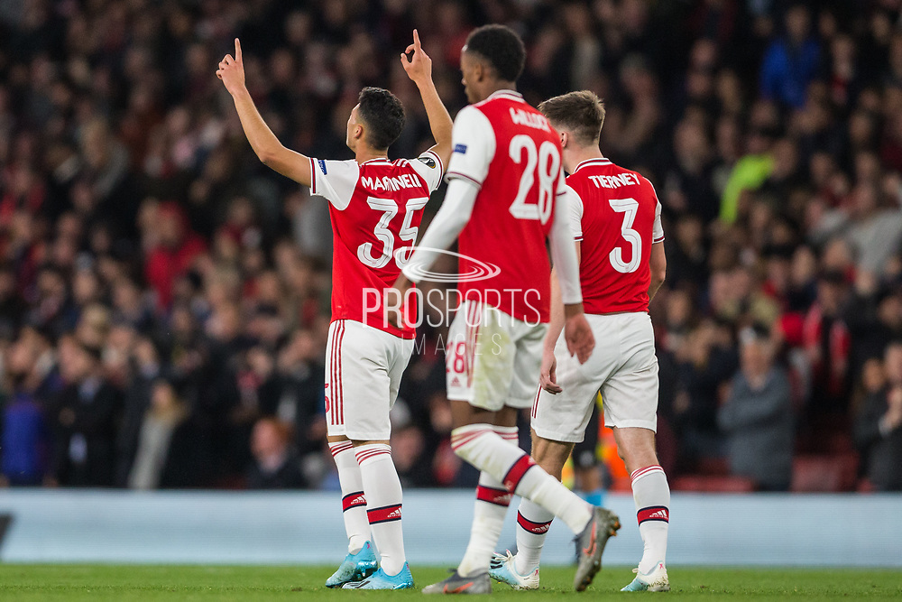 Gabriel Martinelli (Arsenal) celebrates his goal with Joe Willock (Arsenal) & Kieran Tierney (Arsenal) during the Europa League match between Arsenal and Standard Liege at the Emirates Stadium, London, England on 3 October 2019.