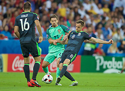 LYON, FRANCE - Wednesday, July 6, 2016: Wales' Andy King in action against Portugal's Adrien Silva during the UEFA Euro 2016 Championship Semi-Final match at the Stade de Lyon. (Pic by David Rawcliffe/Propaganda)