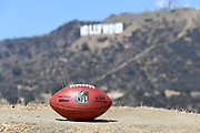 General overall view of NFL official Wilson Duke football with the Hollywood sign and Mount Lee as a backdrop in Los Angeles, Wednesday, Sept. 19, 2018. After more than two decades without an NFL team in Los Angeles, the Rams relocated from St. Louis in 2016 and the Chargers moved from San Diego  in 2017. The teams will share a stadium financed by Rams owner Stan Kroenke at the LA Stadium and Entertainment District in Inglewood, Calif. scheduled to be completed in 2020.