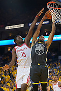 April 30, 2019; Oakland, CA, USA; Golden State Warriors guard Andre Iguodala (9) drives to the basket against Houston Rockets center Clint Capela (15) during the fourth quarter in game two of the second round of the 2019 NBA Playoffs at Oracle Arena. The Warriors defeated the Rockets 115-109.