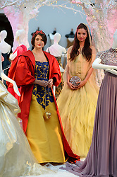 Pictured left is the 'Snow White' dress from the film Snow White designed by Oscar de la Renta and right is the 'Belle' dress from Beauty and the Beast designed by Valentino.<br /> Unique designer dresses inspired by Disney's Iconic Princesses to go under the hammer in aid of Great Ormond Street Hospital at Christie's South Kensington, London, United Kingdom. Friday, 8th November 2013. Picture by Ben Stevens / i-Images