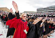 "Associate Dean of Human Ecology Wendy Way, left, sings ""On Wisconsin"" at the close of the University of Wisconsin-Madison commencement ceremony at Camp Randall Stadium, Saturday, May 17, 2014."