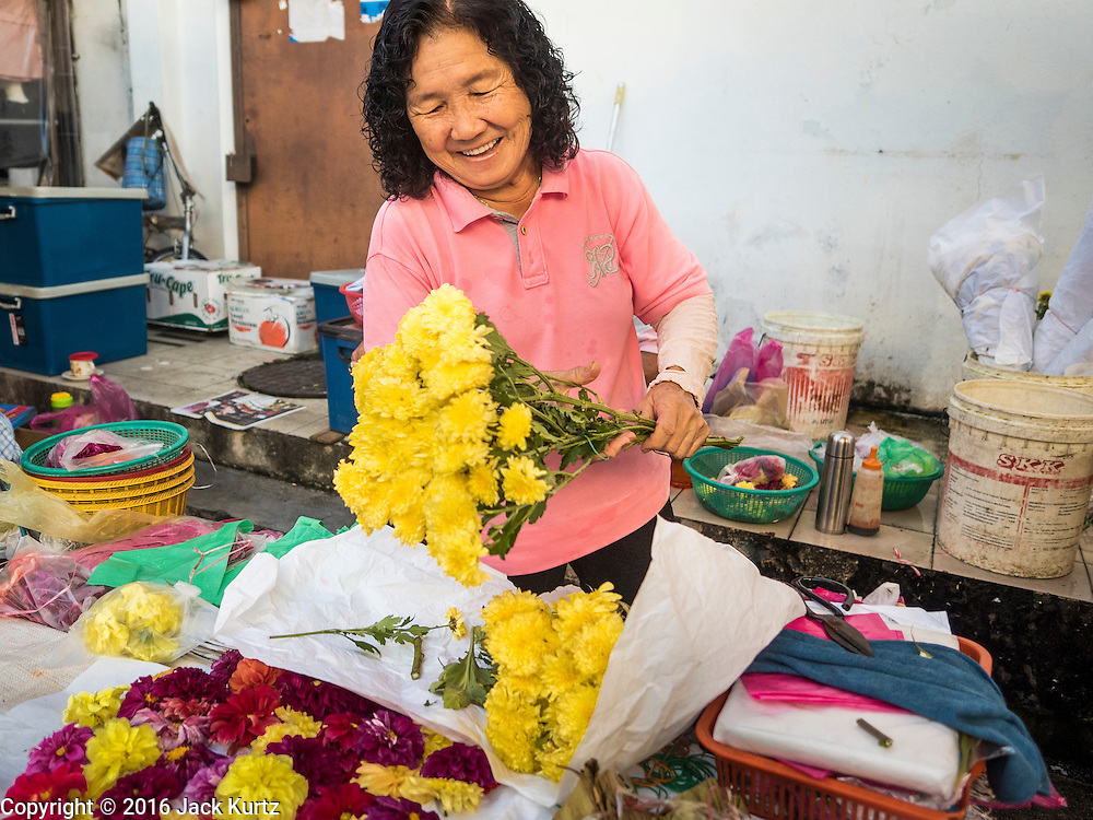 17 NOVEMBER 2016 - GEORGE TOWN, PENANG, MALAYSIA:  A flower vendor in the market in George Town, Penang, Malaysia. George Town is a UNESCO World Heritage city and wrestles with maintaining its traditional lifestyle and mass tourism.       PHOTO BY JACK KURTZ