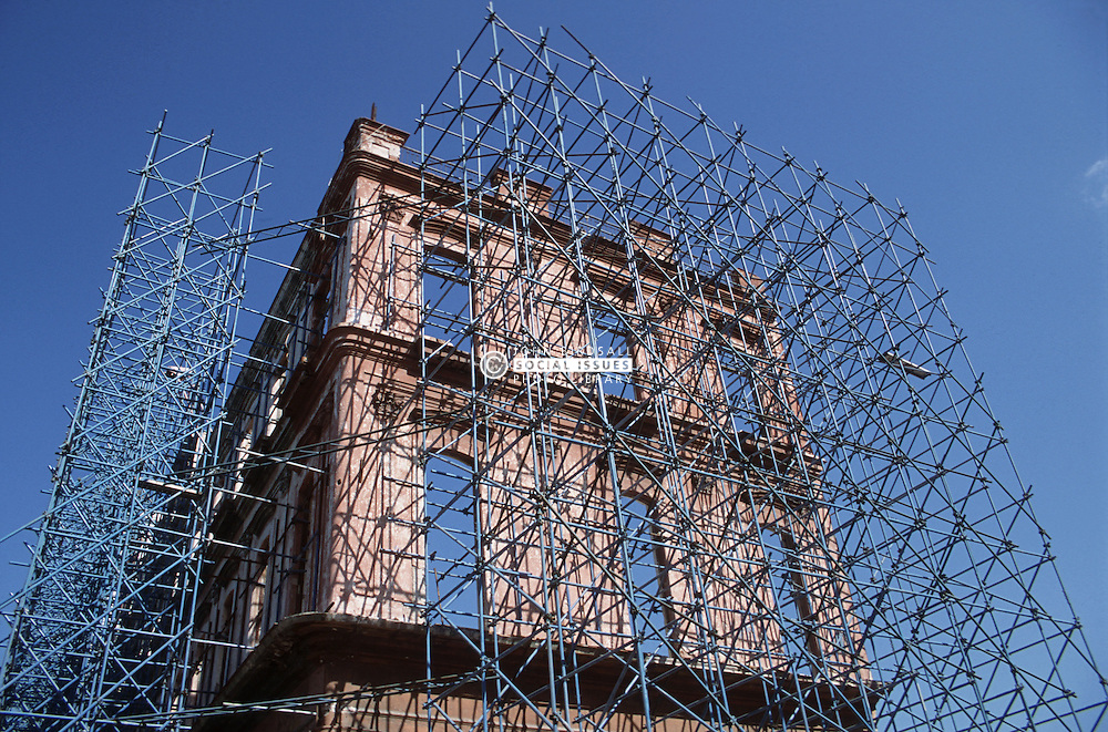 Metal scaffolding on building in Havana which is being restored; the façade being kept and the rest replaced,
