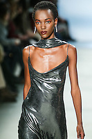 Harieth Paul walks the runway wearing Cushnie et Ochs Fall 2016, hair by Antonio Corral Calero for Moroccanoil, makeup by Val Garland, photographed by Thomas Concordia during New York Fashion Week on February 12, 2016