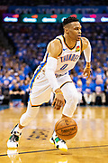 OKLAHOMA CITY, OK - APRIL 21: Russell Westbrook #0 of the Oklahoma City Thunder drives to the basket during a game against the Portland Trail Blazers during Round One Game Three of the 2019 NBA Playoffs on April 21, 2019 at Chesapeake Energy Arena in Oklahoma City, Oklahoma  NOTE TO USER: User expressly acknowledges and agrees that, by downloading and or using this photograph, User is consenting to the terms and conditions of the Getty Images License Agreement.  The Trail Blazers defeated the Thunder 111-98.  (Photo by Wesley Hitt/Getty Images) *** Local Caption *** Russell Westbrook