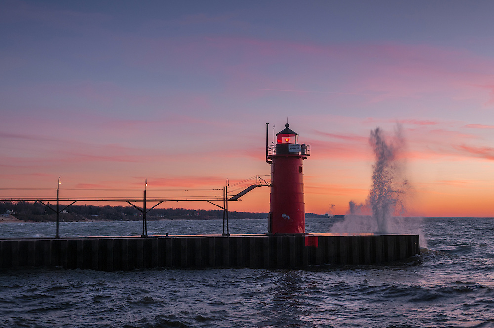 A Lake Michigan wave bursts off the pier at South Haven.