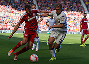 Middlesbrough FC striker Christian Stuani holds the ball from Leeds United FC defender Charlie Taylor  during the Sky Bet Championship match between Middlesbrough and Leeds United at the Riverside Stadium, Middlesbrough, England on 27 September 2015. Photo by George Ledger.